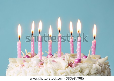 Birthday cake with pink candles - stock photo