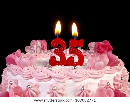 Birthday cake with red candles showing Nr. 35 - stock photo