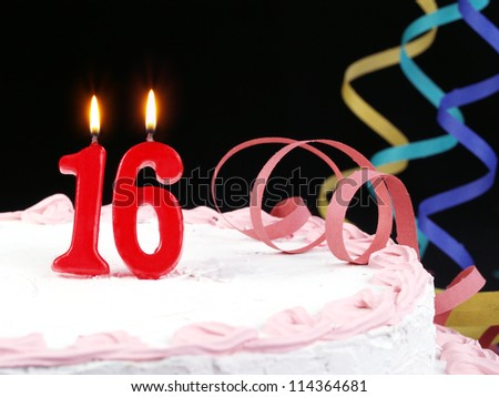 Birthday cake with red candles showing Nr. 16 - stock photo