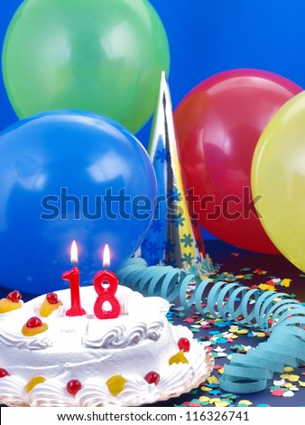 Birthday cake with red candles showing Nr. 18 - stock photo