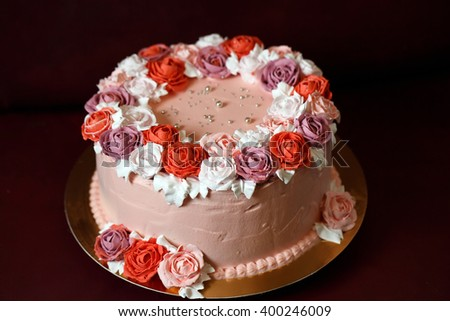 Birthday cake with red roses. - stock photo