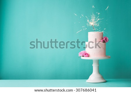 Birthday cake with sparkler - stock photo