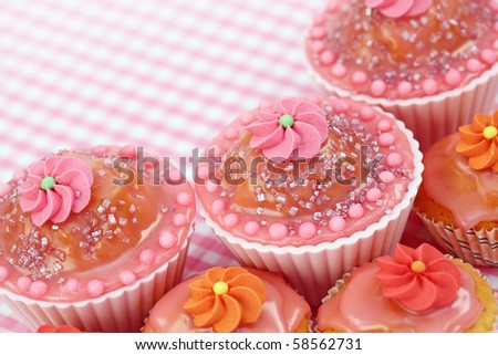Birthday cakes on pink background - stock photo