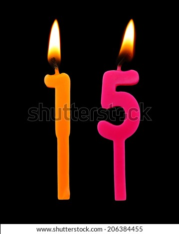 Birthday candle on black background, number 15 - stock photo