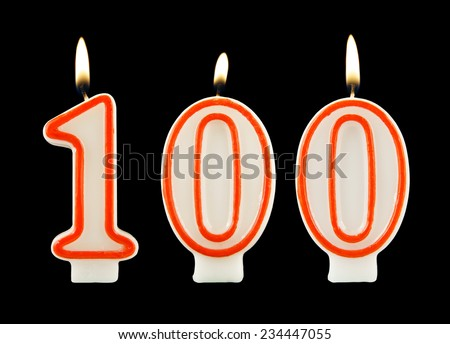 Birthday candle on black background, number 100 - stock photo