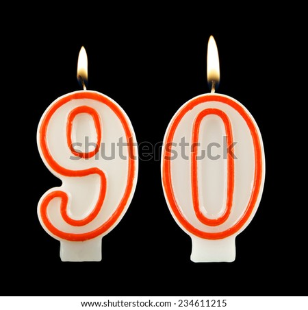 Birthday candle on black background, number 90 - stock photo