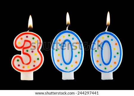Birthday candle on black background, number 300 - stock photo