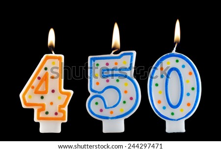Birthday candle on black background, number 450 - stock photo