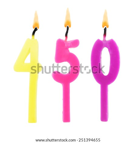 Birthday candle on white background, number 450 - stock photo