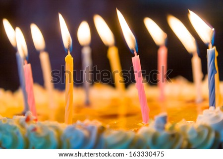 Birthday candles on a cake - stock photo
