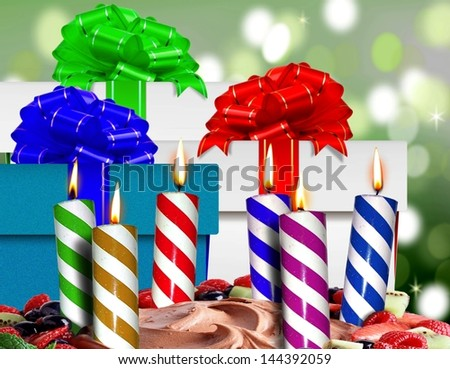 Birthday candles on a cake and gift boxes
