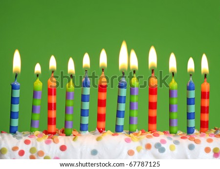 Birthday candles on green background - stock photo