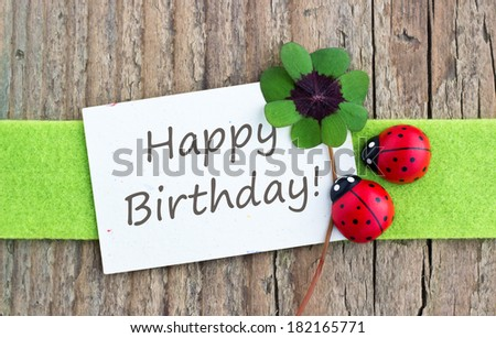 Birthday card with leafed clover and ladybugs/happy birthday/english - stock photo
