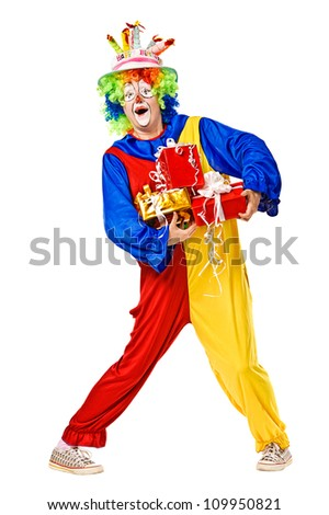 Birthday clown holding gift boxes. Isolated over white