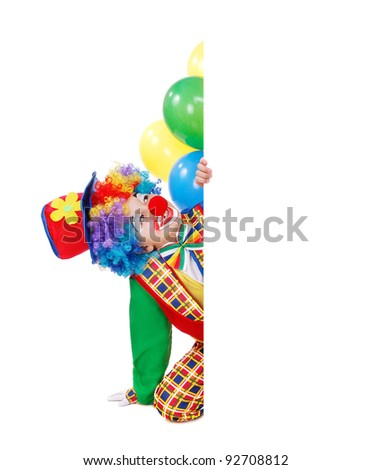 Birthday clown sitting on the floor behind the blank board - stock photo