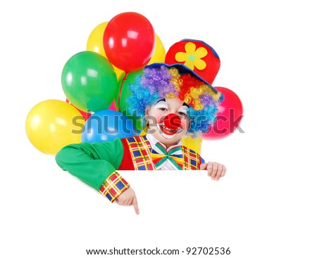 Birthday clown with balloons pointing with his finger to the blank board over the white background - stock photo