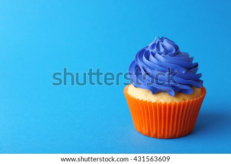 Birthday cupcake on blue background - stock photo