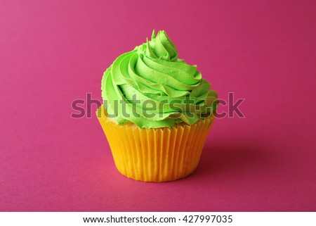 Birthday cupcake on pink background