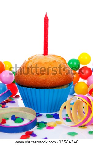 Birthday cupcake with candle streamers and colorful confetti over white background