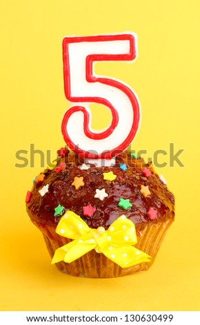 Birthday cupcake with chocolate frosting on background - stock photo