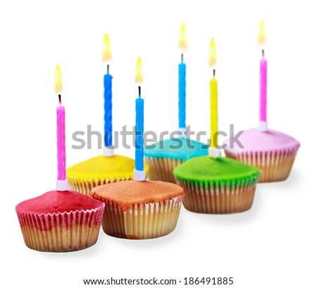 Birthday cupcakes in different colors isolated on white background - stock photo