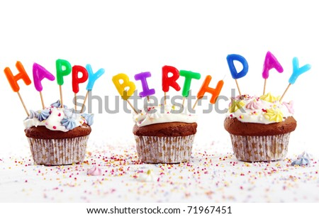 Birthday cupcakes with colorul  candles on white background - stock photo