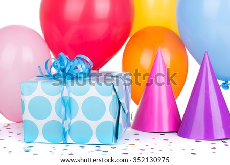 Birthday gift box with balloons and party hats on a white background - stock photo