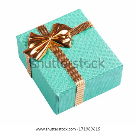 Birthday gift textured cardboard green box wired by gold ribbon bow and knot highlighted by sun or lamp isolated on white background. Clipping path included - stock photo