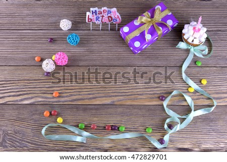 birthday gifts on wooden background,top view