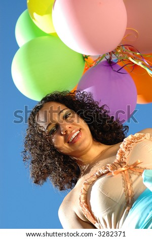 Birthday girl in a pretty dress with plenty of copy space - stock photo