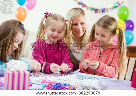 Birthday: Girls Making Crown Crafts At Party - stock photo
