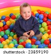 Birthday of fun boy in color balls. - stock photo
