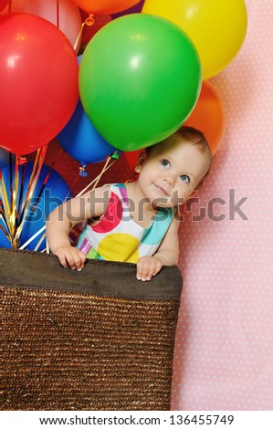 birthday one year old girl with balloons - stock photo