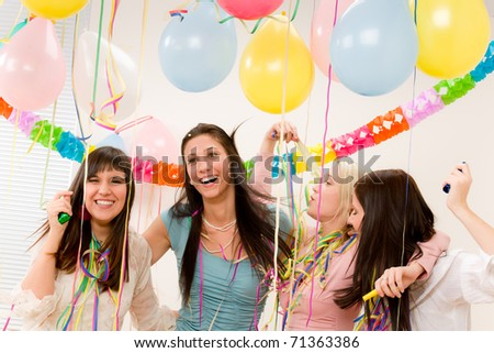 Birthday party celebration - four woman with confetti have fun, toast, dance - stock photo