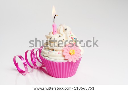 birthday party cupcake with festoon and candle - stock photo