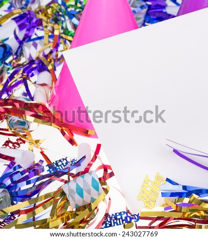 Birthday party decorations with a blank envelope for copy space - stock photo