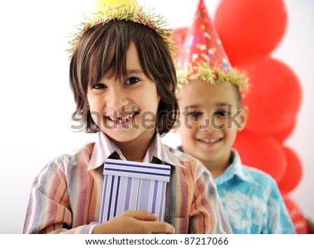 Birthday party, happy children celebrating, balloons and presents around - stock photo
