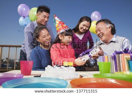 Birthday party, multi-generation family - stock photo