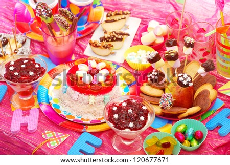 birthday party with homemade torte and fruit sweets for children - stock photo