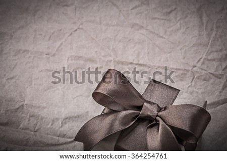 Birthday present box with bow on wrapping paper holidays concept. - stock photo