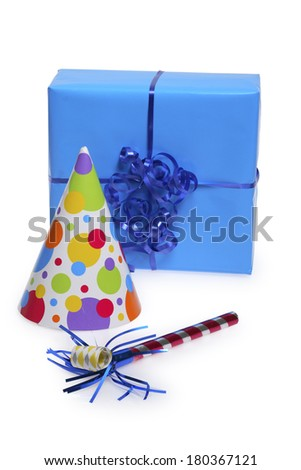 Birthday present, party hat and noise maker on white  - stock photo