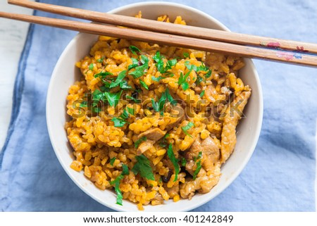 biryani chicken rice fried in bowl with chopstick - stock photo