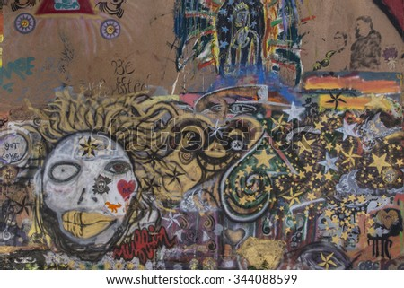 Bisbee, AZ, USA - May 24, 2015: Colored graffiti on a wall in quirky Bisbee. - stock photo