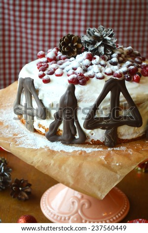 biscuit cake with curd cream decorated with cranberries, Christmas sweets - stock photo