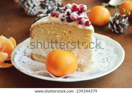biscuit cake with curd cream decorated with cranberries, Christmas sweets.orange, Christmas mood - stock photo
