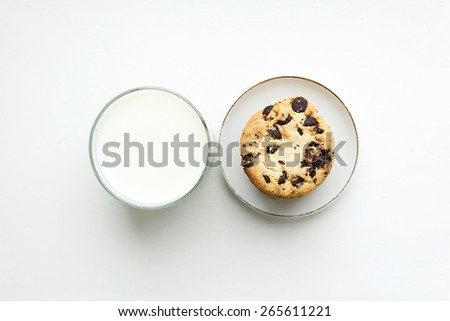 Biscuit cookies with chocolate chips and a glass of milk. Top view - stock photo