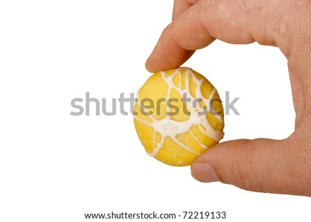 Biscuit dough with icing and jam filling. - stock photo