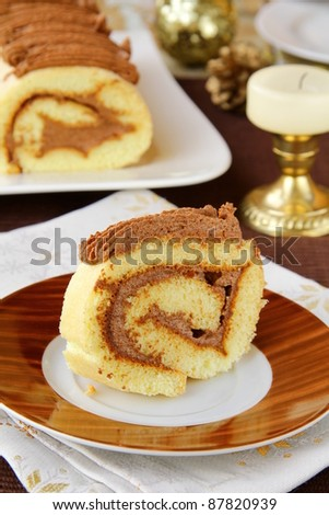 biscuit roulade with chocolate  cream - stock photo