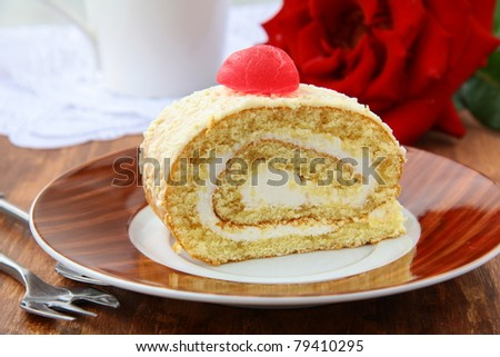 biscuit roulade with cream and white chocolate - stock photo