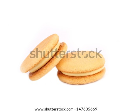 Biscuit sandwich with white filling. Close up. - stock photo